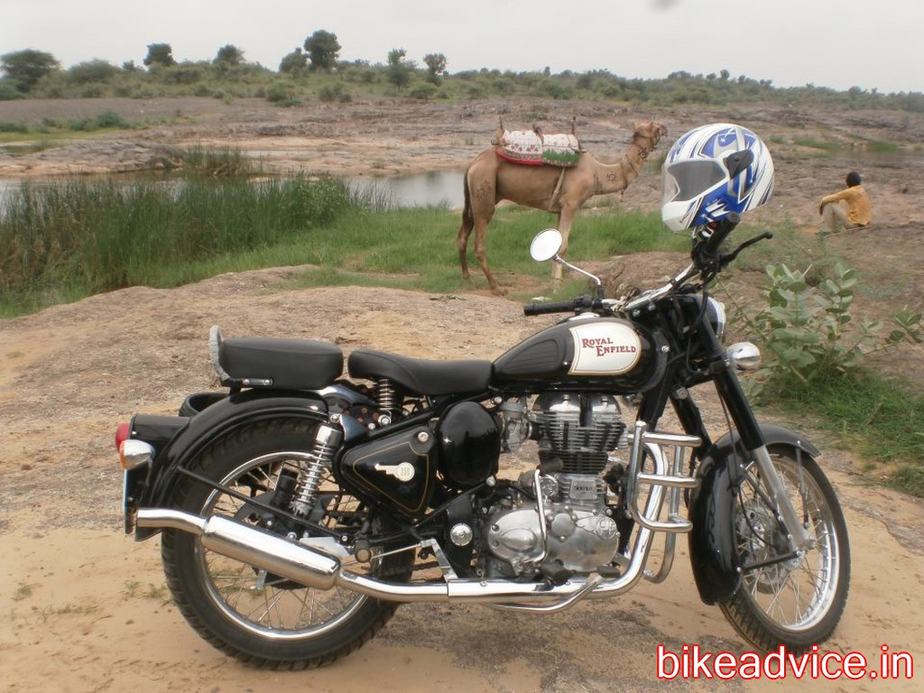 Black Royal Enfield Wallpaper Watching a Royal Enfield